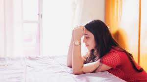 Woman Praying Earnestly